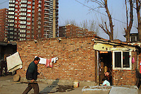 China, Beijing, Ping Fang Xiang, 2008. Coping with year-round construction is the unfortunate lot of these Ping Fang Xiang families close to new developments. .