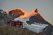 Within 15 minutes walk from Stellisee lake, relax at Bergrestaurant Fluhalp at the heart of the Sunnegga-Blauherd-Rothorn hiking & ski region, in Zermatt, the Pennine/Valais Alps, Switzerland, Europe. Experience Stellisee best at sunrise with great reflections of the Matterhorn, after overnight stay at Fluhalp (half board meals, coin showers, private rooms & dormitory), 40 minutes walk from Blauherd lift. The best parts of the Five Lakes Trail / 5-Seenweg loop are the old wood buildings in upper Findeln, and the reflecting lakes of Grindjisee and Stellisee.