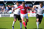 Wrexham Forward Jordan White clears a path during the Vanarama National League match between Bromley FC and Wrexham FC at Hayes Lane, Bromley, United Kingdom on 8 April 2017. Photo by Jon Bromley.