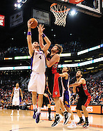 Jan. 24, 2012; Phoenix, AZ, USA; Phoenix Suns center Marcin Gortat (4) puts up a shot against the Toronto Raptors center Aaron Gray (34) during the second half at the US Airways Center. The Raptors defeated the Suns 99-96. Mandatory Credit: Jennifer Stewart-US PRESSWIRE.