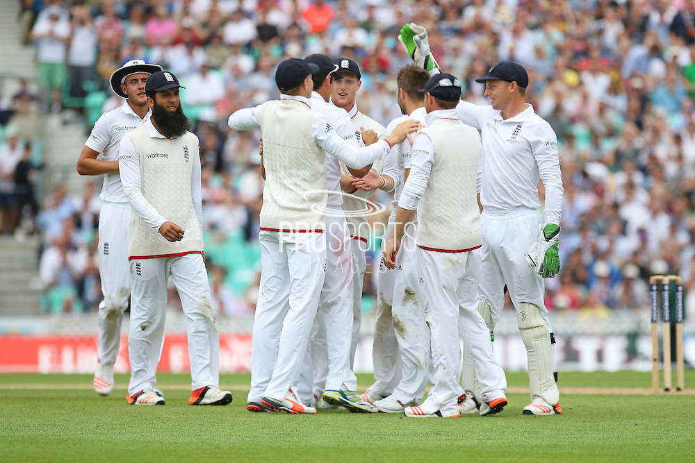 Mark Wood of England is congratulated after taking the wicket of Chris Rogers of Australia for 43 during the 1st day of the 5th Investec Ashes Test match between England and Australia at The Oval, London, United Kingdom on 20 August 2015. Photo by Phil Duncan.