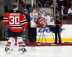 November 28, 2007; Newark, NJ, USA;  New Jersey Devils goalie Martin Brodeur (30) is presented with a painting honoring his 500th win before the first period of the Devils game against the Dallas Stars at the Prudential Center in Newark, NJ.