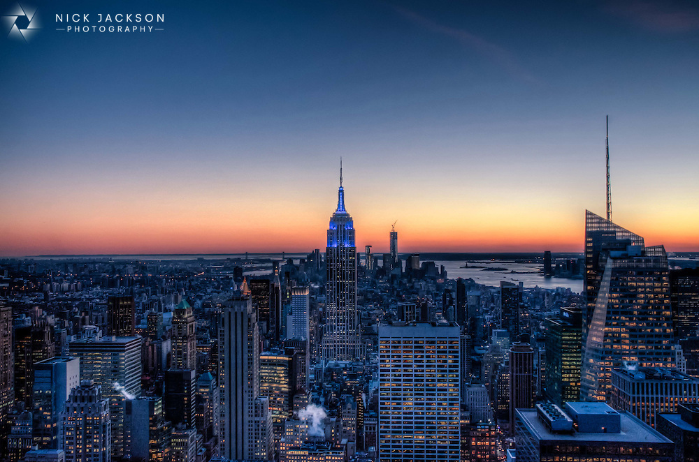 There are few better cityscapes than that from the top of the Rockefeller Center in New York. Many prefer to venture up the Empire State Building but from the Top of the Rock you get that famous landmark, and many more, included in the shot. <br /> <br /> The sunset was incredible on the cold January night I took this picture. Despite not dressing appropriately for an outside evening jaunt 70 floors up, I stayed late into the night to watch the sun set behind the Statue of Liberty and Manhattan Island spring to life far below.