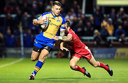 Leeds Rhinos' Tom Briscoe (left) and Salford Red Devils' Gareth O'Brien (right) during the Betfred Super8's match at Headingley Carnegie, Leeds.