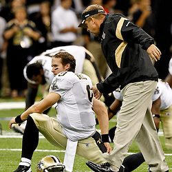 August 12, 2011; New Orleans, LA, USA; New Orleans Saints quarterback Drew Brees (9) talks with head coach Sean Payton prior to kickoff of a preseason game against the San Francisco 49ers at the Louisiana Superdome. Mandatory Credit: Derick E. Hingle