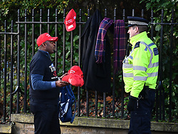© Licensed to London News Pictures. 03/12/2019. London, UK. A Donald Trump supporter is seen talking to police at Winfield House in Regents Park, London, where President Donald Trump is staying during the NATO leaders summit. Worlds leaders are due to attend a series of events over a two day NATO summit which will mark the 70th anniversary of the alliance of nations. Photo credit: Ben Cawthra/LNP