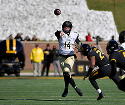 Nov 10, 2018; Columbia, MO, USA; Vanderbilt Commodores quarterback Kyle Shurmur (14) throws a pass as Missouri Tigers linebacker Terez Hall (24) attempts the tackle during the first half at Memorial Stadium/Faurot Field. Mandatory Credit: Denny Medley-USA TODAY Sports