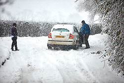 © Licensed to London News Pictures. 10/12/2017. AYLESBURY, UK.  A car stuck on a hill near Aylesbury. Heavy snow is causing widespread transport problems with Thames Valley Police advising drivers not to travel.  Photo credit: Cliff Hide/LNP