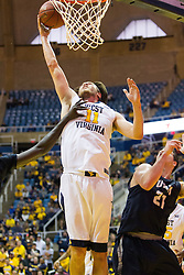 Nov 20, 2016; Morgantown, WV, USA; West Virginia Mountaineers forward Nathan Adrian (11) shoots a layup during the second half against the New Hampshire Wildcats at WVU Coliseum. Mandatory Credit: Ben Queen-USA TODAY Sports