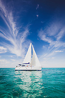 The Grand Illusion II under full sail in the Exumas, Bahamas. A charter sailboat it is available for bareboating escapades.