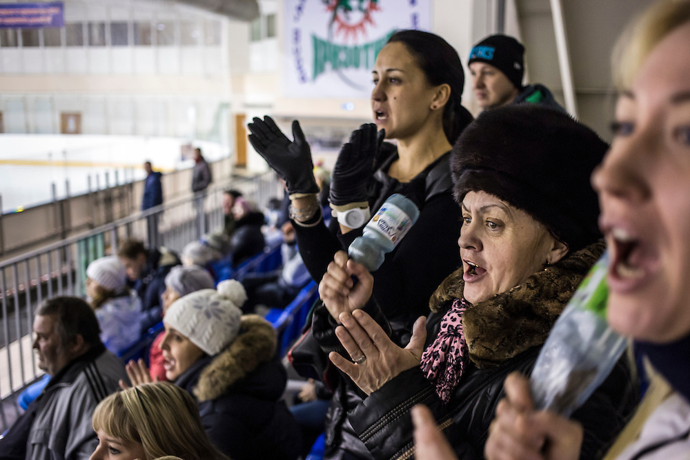 Parents of players cheer on Chrysotile, a local youth hockey team, during a game against a local rival on Sunday, December 1, 2013 in Asbest, Russia. The team is named for chrysotile asbestos, the type mined from a quarry in the town.