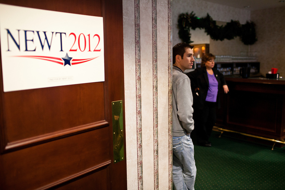 People wait for Republican presidential candidate Newt Gingrich to arrive at a Rotary Club meeting on Tuesday, December 27, 2011 in Dubuque, IA.