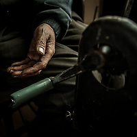 """Those rich Chinese in the eastern provinces, they pay lots of money for our coal but they have no idea about the price we pay. Our bitterness is their happiness,"" says Liao Jianguo. Liao is paralyzed from the waist down. A detail of the hand crank Liao Jianguo uses to propel his wheelchair."