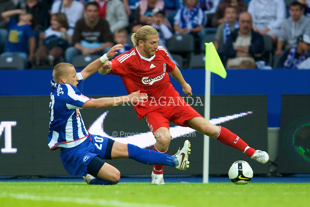 BERLIN, GERMANY - Tuesday, July 22, 2008: Liverpool's Andriy Voronin is tackled by Hertha BSC Berlin's Patrick Ebert during a pre-season friendly match at the Olympiastadion. (Photo by David Rawcliffe/Propaganda)