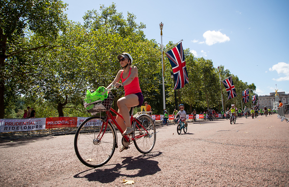 Riders pass along The Mall. The Prudential RideLondon FreeCycle. Saturday 28th July 2018<br /> <br /> Photo: Jed Leicester for Prudential RideLondon<br /> <br /> Prudential RideLondon is the world's greatest festival of cycling, involving 100,000+ cyclists - from Olympic champions to a free family fun ride - riding in events over closed roads in London and Surrey over the weekend of 28th and 29th July 2018<br /> <br /> See www.PrudentialRideLondon.co.uk for more.<br /> <br /> For further information: media@londonmarathonevents.co.uk