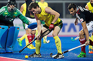 BHUBANESWAR (India) -  Hero Champions Trophy hockey men. Semifinal Germany vs Australia. Fergus Kavanagh of Australia with German Timur Oruz . left goalkeeper Nicolas Jacobi. Photo Koen Suyk