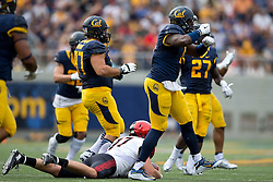 BERKELEY, CA - SEPTEMBER 12:  Defensive end Jonathan Johnson #11 of the California Golden Bears celebrates after sacking quarterback Maxwell Smith #17 of the San Diego State Aztecs during the third quarter at California Memorial Stadium on September 12, 2015 in Berkeley, California. The California Golden Bears defeated the San Diego State Aztecs 35-7. (Photo by Jason O. Watson/Getty Images) *** Local Caption *** Jonathan Johnson; Maxwell Smith
