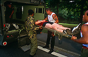 An Officer Cadet at the Royal Military Academy Sandhurst is loaded into the back of a British Army Land Rover ambulance to join the downfacing trainers of a collapsed colleague, after retiring  from an endurance race. Recruits run a 5 mile steeplechase around the Academy grounds to assess individual stamina and accumulate team points. Sandhurst is an institution which has bred staff officers since 1800. Today it trains future officers for the demands of leadership and military understanding of military understanding,. Students are tested for their command instincts, intellect, strength of character and physical endurance often under great psychological pressure - the demands asked of them in modern warfare. Failure in this test might not necessarily mean dismissal though perserverence or refusal to give up won't harm their prospects.