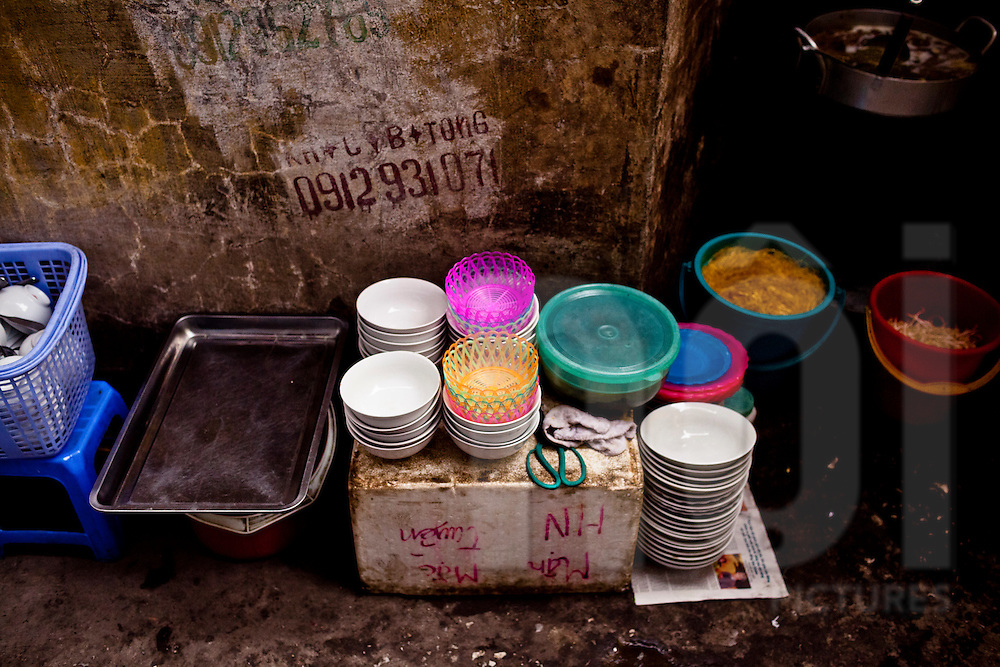 Bowls piled up along a street sidewalk, Hanoi, Vietnam, Southeast Asia
