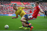 Kemar Roofe (Oxford United) is fouled during the Johnstone's Paint Trophy Final between Barnsley and Oxford United at Wembley Stadium, London, England on 3 April 2016. Photo by Mark P Doherty.