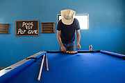 Sol Neelman, from Portland Oregon, plays a game of pool at the Park Bar in Boquillas del Carmen on May 14, 2014.