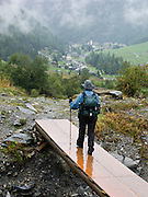 We finish a cloudy, rainy day hiking the Haute Route on a wet descent to lodging at the village of Trient, Switzerland, the Alps, Europe. Hike the High Route (Chamonix-Zermatt Haute Route) or Tour du Mont Blanc for great scenery and Old World charm.