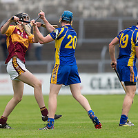 Tulla's Niall Bolton and Newmarket-on-Fergus's Nial O'Connor clash during the Senior Hurling game
