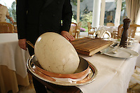 Maitre d'Hotel Dominique prepares the Poulard in the dining room.. Hotel Bristol, Paris..Chef Eric Frechon.....photo by Owen Franken