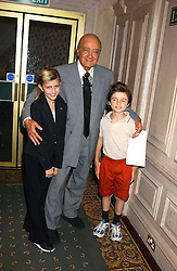 MOHAMED AL FAYED with KIRSTEEN LUPTON and LOUIS BURROWS at a fashion show featuring designs by Diesel Kid's FW05 collection held in The Georgian Restaurant at Harrod's on 1st September 2005.  Proceeds from the event went to the Graet Ormond Street Hospital.<br /><br />NON EXCLUSIVE - WORLD RIGHTS