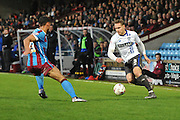 Chris Hussey (3) of Bury up against Jordan Clarke of Scunthorpe United  during the Sky Bet League 1 match between Scunthorpe United and Bury at Glanford Park, Scunthorpe, England on 19 April 2016. Photo by Ian Lyall.