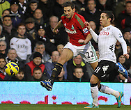 Picture by David Horn/Focus Images Ltd +44 7545 970036.29/12/2012.Kerim Frei of Fulham (right) and Angel Rangel of Swansea City (left) during the Barclays Premier League match at Craven Cottage, London.