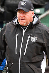 December 19, 2010; Oakland, CA, USA;  Oakland Raiders head coach Tom Cable enters the field before the game against the Denver Broncos at Oakland-Alameda County Coliseum.