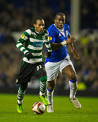 LIVERPOOL, ENGLAND - Tuesday, February 16, 2010: Everton's Sylvain Distin brings down Sporting Clube de Portugal's Liedson for a penalty during the UEFA Europa League Round of 32 1st Leg match at Goodison Park. (Photo by: David Rawcliffe/Propaganda)