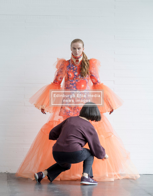 Pictured: design by student Franz Maggs get's some finishing touches before the degree show.<br /> <br /> Students studying fashion design at Glasgow School of Art previewed their work before their annual degree show.<br /> <br /> © Dave Johnston / EEm