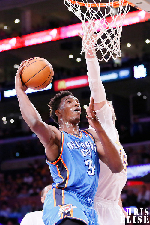 09 March 2014: Oklahoma City Thunder center Hasheem Thabeet (34) goes for the dunk over Los Angeles Lakers center Pau Gasol (16) during the Los Angeles Lakers 114-110 victory over the Oklahoma City Thunder at the Staples Center, Los Angeles, California, USA.