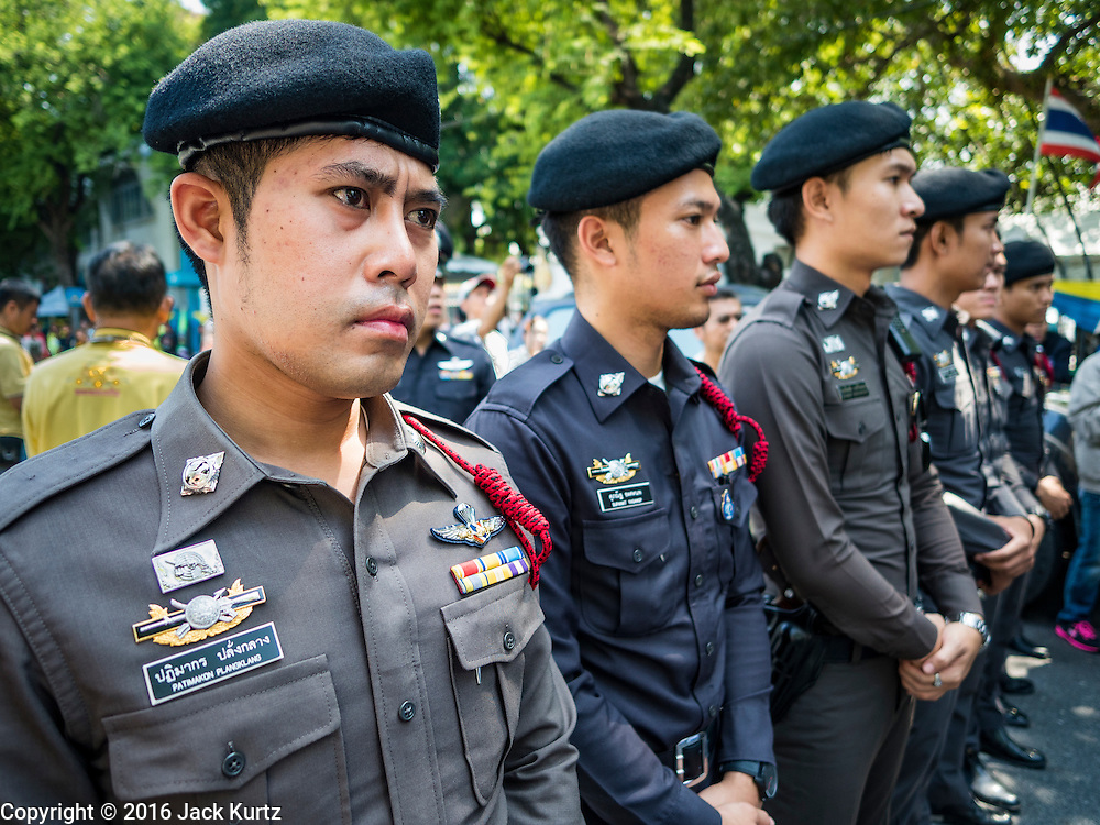 03 OCTOBER 2016 - BANGKOK, THAILAND:  Thai police block protesters from approaching the Prime Minister's office during a World Habitat Day protest in Bangkok. In 1985, the UN General Assembly declared that World Habitat Day would be observed on the first Monday of October every year.  The declaration noted that every person deserves a decent place to live. In Bangkok this year, hundreds of people marched to the United Nations' offices to deliver a letter addressed to the UN Secretary General noting that forced evictions to facilitate urban renewal and gentrification was resulting in an increase in homelessness and substandard housing. Protesters and housing rights' activists also marched to the Prime Minister's Office and Bangkok city hall to express their concerns.     PHOTO BY JACK KURTZ
