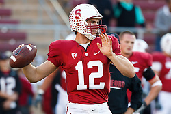 November 6, 2010; Stanford, CA, USA;  Stanford Cardinal quarterback Andrew Luck (12) warms up before the game against the Arizona Wildcats at Stanford Stadium.