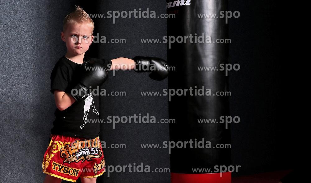 27.05.2013, Sporthalle, Reutlingen, GER, Tyson, der juengste Kickboxer, im Bild Tyson der warscheinlich juengste Kickboxer der Welt bei einem Fotoshooting. Mit 5 Jahren und einer Groesse von 1,15 cm ist er schon Mitglied im Easy Sport Kickbox Team Reutlingen, seine Hose wurde extra in Thailand hergestellt und ist schon mit seinem Name Tyson beschriftet // Tyson probably the youngest Kickboxer in the world // during a photo shoot. He is5 years old and he have a height of 1.15 cm. The young Kickboxer is already a member of the Easy Sport Kickboxing Team Reutlingen, his pants were specially made ??in Thailand and is already inscribed with his name Tyson, Sportcenter, Reutlingen, Germany on 2013/05/27. EXPA Pictures © 2013, PhotoCredit: EXPA/ Eibner/ Eckhard Eibner..***** ATTENTION - OUT OF GER *****