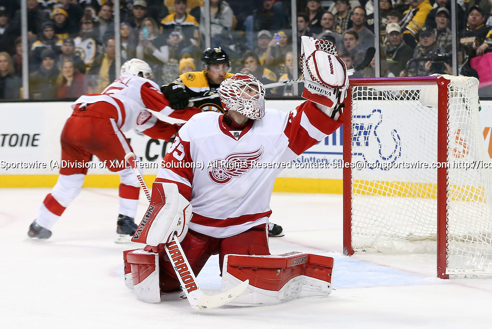 December 29, 2014: Detroit Red Wings Goalie Jimmy Howard (35) [3772] makes a glove save. The Boston Bruins defeated the Detroit Red Wings 5-2 in a regular season NHL game at TD Garden in Boston, Massachusetts.