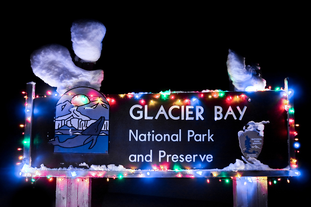 Bright and colorful bulbs light up the Glacier Bay park sign during the holiday season.