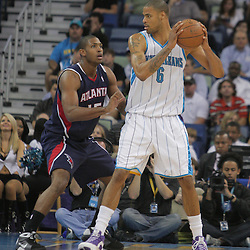 05 November 2008: New Orleans Hornets center Tyson Chandler (6) posts up against Atlanta Hawks center Al Horford (15) during the first half of a NBA game between the New Orleans Hornets and the Atlanta Hawks at the New Orleans Arena in New Orleans, LA..