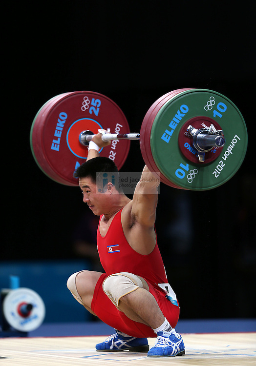 Un Guk Kim of the Democratic People's Republic of Korea lifts 153kg for an Olympic record during the mens 62kg weightlifting event during day 3 of the London Olympic Games London, 30 Jul 2012..(Jed Jacobsohn/for The New York Times)....