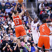24 March 2014: Milwaukee Bucks guard Ramon Sessions (13) takes a jump shot over Los Angeles Clippers guard Darren Collison (2) during the Los Angeles Clippers 106-98 victory over the Milwaukee Bucks at the Staples Center, Los Angeles, California, USA.