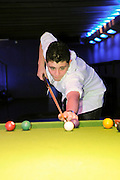 Teen boy plays Billiards Model release available