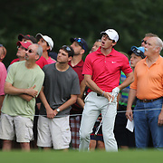 Rory McIlroy reacts as a wayward shot finds the bunker on the 12th hole during the first round of theThe Barclays Golf Tournament at The Ridgewood Country Club, Paramus, New Jersey, USA. 21st August 2014. Photo Tim Clayton