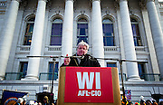 MADISON, WI — FEBRUARY 24: AFL-CIO President Phil Neuenfeldt speaks at the podium outside the Wisconsin State Capitol as workers and labor unions protested a right-to-work bill going through the state legislature.