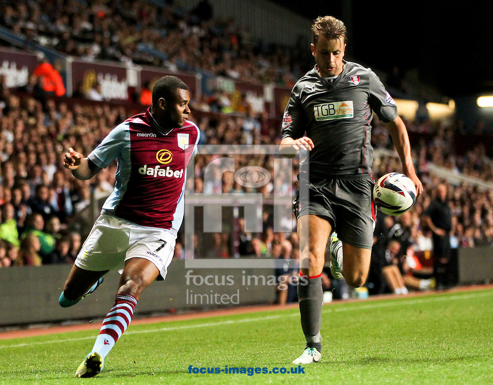 Picture by Tom Smith/Focus Images Ltd 07545141164<br /> 28/08/2013<br /> Leandro Bacuna (left) of Aston Villa battles for the ball with Karl Arnason (right) of Rotherham United during the Capital One Cup match at Villa Park, Birmingham.