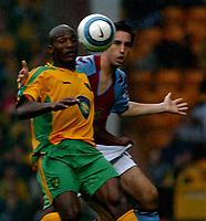 Photo. Daniel Hambury.Digitalsport<br /> Barclays Premiership.    <br /> Norwich City v Aston Villa.<br /> 18/09/2004.<br /> Norwich City's Damien Francis and Aston Villa's Peter Whittingham