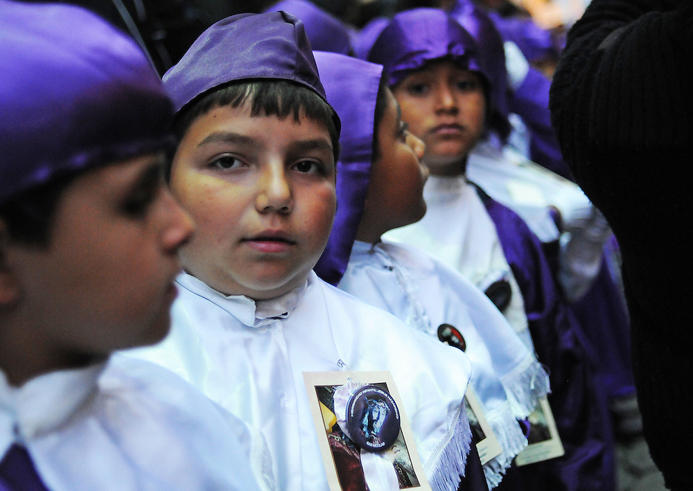 Apr 21, 2011 - Quetzaltenago, Guatemala - Children dressed as Cucuruchos carry smaller images of Jesus Christ and the Virgin Mary, during the Children's Procession through the streets of Quetzaltenago..(Credit Image: © Josh Bachman/ZUMA Press)