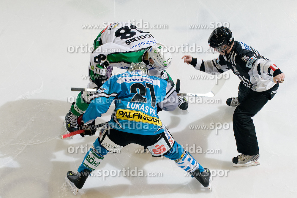 Philipp Lukas (EHC Liwest Black Wings Linz, #21) and Matt Higgins (HDD Tilia Olimpija, #88) during ice-hockey match between HDD Tilia Olimpija and EHC Liwest Black Wings Linz in 37th Round of EBEL league, on Januar 9, 2011 at Hala Tivoli, Ljubljana, Slovenia. (Photo By Matic Klansek Velej / Sportida.com)